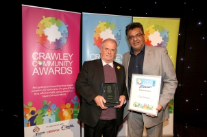 Crawley Community Awards 2016. Richard Symonds receives the Environment award on behalf on the winner David Moon, from Bharat Lukka. Photo by Derek Martin