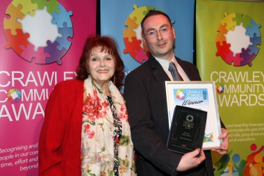 Crawley Community Awards 2016. Craig Downs presents the Inspiration award to Julia Klemkerk. Photo by Derek Martin