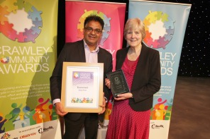 DM17311496a.jpg. Crawley Community Awards, 2017. Jenny Frost receives the Environment award from Bharat Lukka. Photo by Derek Martin