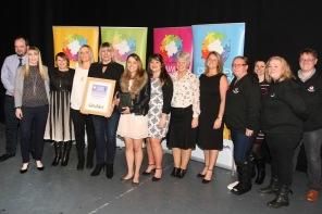 DM17311606a.jpg. Crawley Community Awards, 2017. Group Achievement award presented by Blaise Tapp to Crawley Old Girls. Photo by Derek Martin