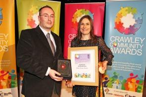 DM17311605a.jpg. Crawley Community Awards, 2017. Craig Downs presents the Individual Achievement award to Katie-George Dunlevy. Photo by Derek Martin
