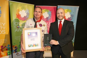 DM17311610a.jpg. Crawley Community Awards, 2017. Cllr Peter Lamb presents the Inspiration award to Scout Leader Paul Masters. Photo by Derek Martin