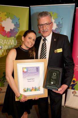 DM17311569a.jpg. Crawley Community Awards, 2017. Maria Cook receives the Local Hero award fromJohn Wright MBE. Photo by Derek Martin