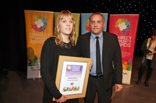 DM17311522a.jpg. Crawley Community Awards, 2017. Natalie Greenhough receives the Sports person award from Dave Downey. Photo by Derek Martin