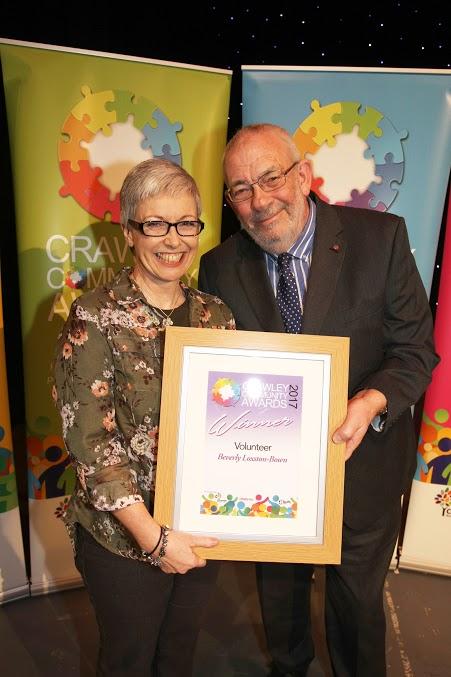 DM17311574a.jpg. Crawley Community Awards, 2017. Beverly Loxton-Brown receives the Volunteer award fron Peter Mansfield-Clark MBE. Photo by Derek Martin