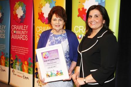 DM1842072a.jpg. Crawley Community Awards 2018. Pride of Crawley, Mary Grace BEM, presneted by Natalie Brahma-Pearl, Chief Executive, Crawley Borough Council. Photo by Derek Martin Photography.